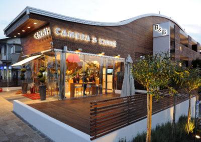 STEFANO FOCACCIA ARCHITETTI Camera & Café, Fosso Ghiaia (RA): edificio residenziale con annesso bar.